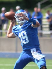 Adam Wagner, Cov Cath senior QB, throws a 30-yard TD pass to Lee McClure in the first half.