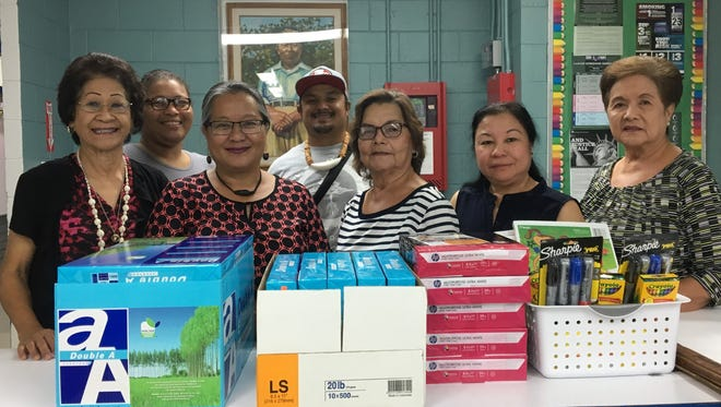 School Supplies were donated to D. L. Perez Elementary in Yigo by the Young Mens League of Guam Ladies Auxiliary on March 1 with the approval of Dr. Kelly Sukola, School Principal. The donation is an ongoing project for a selected GDOE Chamorro Class by the YMLG Ladies Auxiliary to celebrate Chamorro Month. Pictured front row from left: Sera Taitano, Ladies Auxiliary; Benita Lizama, Chamorro Teacher; Sylvia Mendiola, President, Ladies Auxiliary; Rose Pelkey and Sue Carbullido, Ladies Auxiliary.