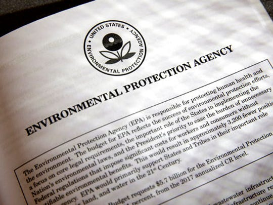 FILE - In this March 16, 2017, file photo, proposals for the Environmental Protection Agency (EPA) in President Donald Trump's first budget are displayed at the Government Printing Office in Washington. President Donald Trump will sign an executive order on March 29 that will suspend, rescind, or flag for review more than half-a-dozen measures that were part of former President Barack Obama's sweeping plan to curb global warming.