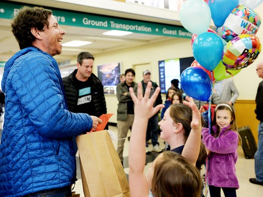 Peter Ripmaster is welcomed home by family and friends at Asheville Regional Airport March 27, 2018 after winning the longest, hardest ultra-marathon in the world, the 1,000-mile Iditarod Trail Invitational across Alaska.