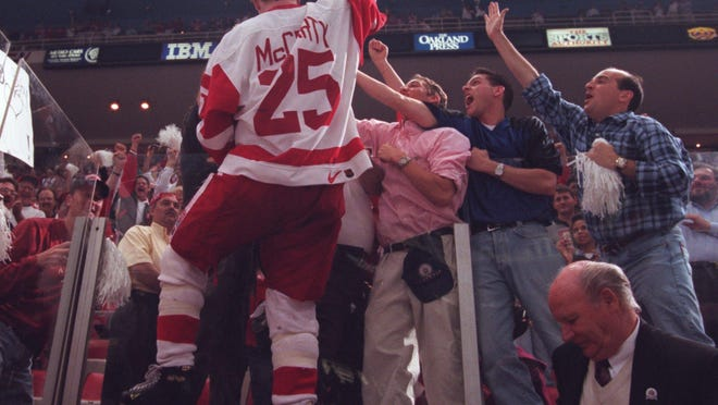 Enforcer Darren McCarty celebrates with fans at The Joe after the Wings swept the Flyers to end their Cup drought in 1997.