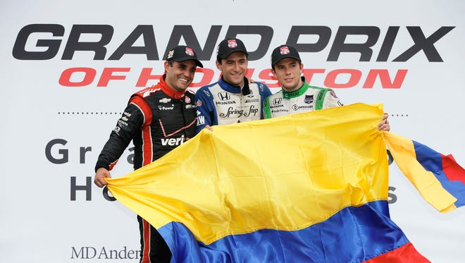 Winner Carlos Huertas, center, runner-up Juan Pablo Montoya, left, and Carlos Munoz gave Colombia a sweep of the podium Saturday at the Grand Prix of Houston.