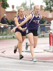 Melrose's Camryn Brinkman hands the baton off to Madalyn