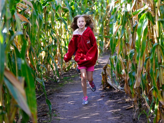 Abby Yagow, 11, of Downs, Ill., runs through the trilobite