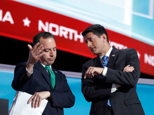 House Speaker Paul Ryan of Wisconsin (right) and Reince Priebus, chairman of the Republican National Committee, talk while Alaska recounts its votes during the second day of the Republican National Convention in Cleveland on July 19.