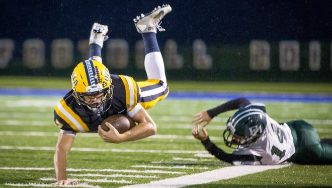 Delta's Blake Green is tackled by Pendleton Height's Thomas Quiroga for a homecoming game Friday night at Delta High School. Pendleton Heights won the game 31-28.