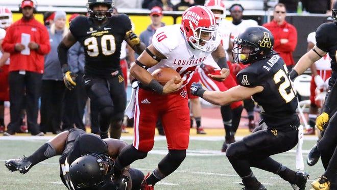 UL freshman quarterback Jordan Davis runs the ball during his late appearance in Saturday's loss to Appalachian State.