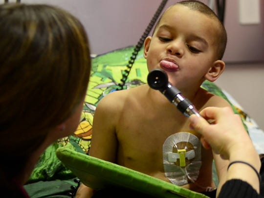 Tae Smith, 4, of Port Clinton defiantly sticks out his tongue when a nurse asks him to open his mouth while undergoing chemotherapy for stage four glioblastoma, a form of aggressive brain cancer with a low survival rate and generally considered incurable. Ten months ago, he had brain surgery to remove a cancerous tumor, and now has chemotherapy twice a month. His doctor optimistically gives him a 20 percent chance of living two-to-three years after diagnosis.
