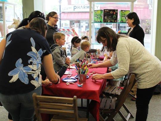 Children decorated their own Fairy Garden Door at the Toy Market on Third Thursday.