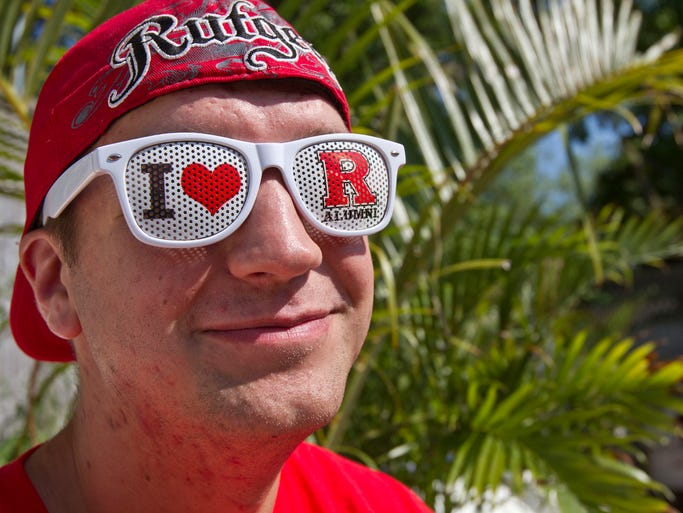 Brad Lynch of Piscataway, a Rutgers senior, enjoys the party. The final stop on the Rutgers Big Ten Tour in partnership with the annual RUAA Young Alumni Beach Party takes place at Bar Anticipation. Lake Como, NJ Saturday, July 12, 2014 Doug Hood/Staff Photographer