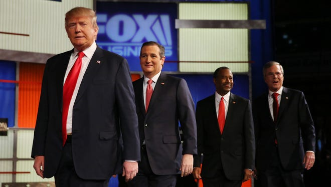 Donald Trump, Ted Cruz, Ben Carson and Jeb Bush arrive for the Fox Business Network Republican presidential debate on Jan. 14, 2016 in North Charleston, S.C.