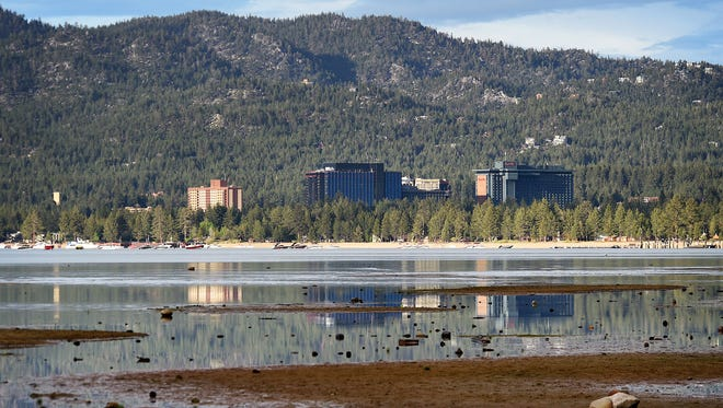 The Stateline and South Lake Tahoe business district is seen reflected in the lake on June 10, 2015.