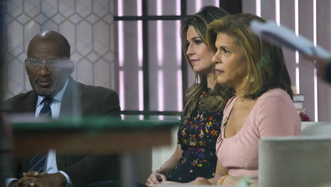 Al Roker, left, Savannah Guthrie and Hoda Kotb prepare for segment on the set of NBC's 'Today Show,' Wednesday. Anchor Matt Lauer has been fired from the show for alleged sexual misconduct.
