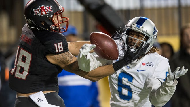 Middle Tennessee cornerback Mike Minter (6) breaks up a pass in the end zone intended for Arkansas State wide receiver Justin McInnis (18) during the first half of the Camellia Bowl on Saturday in Montgomery, Ala.