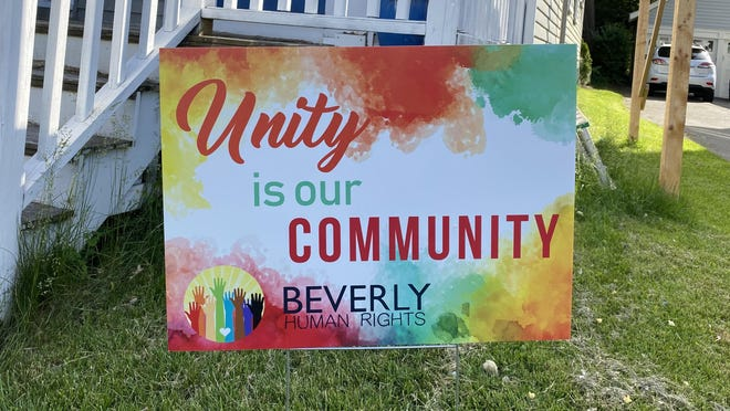 Unity is Our Community signs are beginning to pop up in lawns all over in Beverly, like in front of this home on Corning Street.