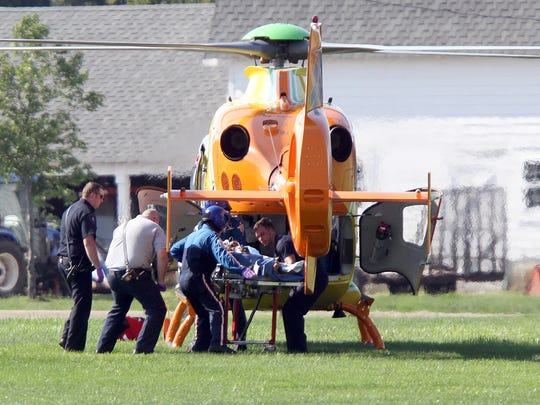 The man who barricaded himself in an Evergreen Road after killing his wife in New Egypt Tuesday, August 25, 2015, is loaded into the MONOC medevac helicopter behind New Egyt High School for transport to Jersey Shore University Medical Center.