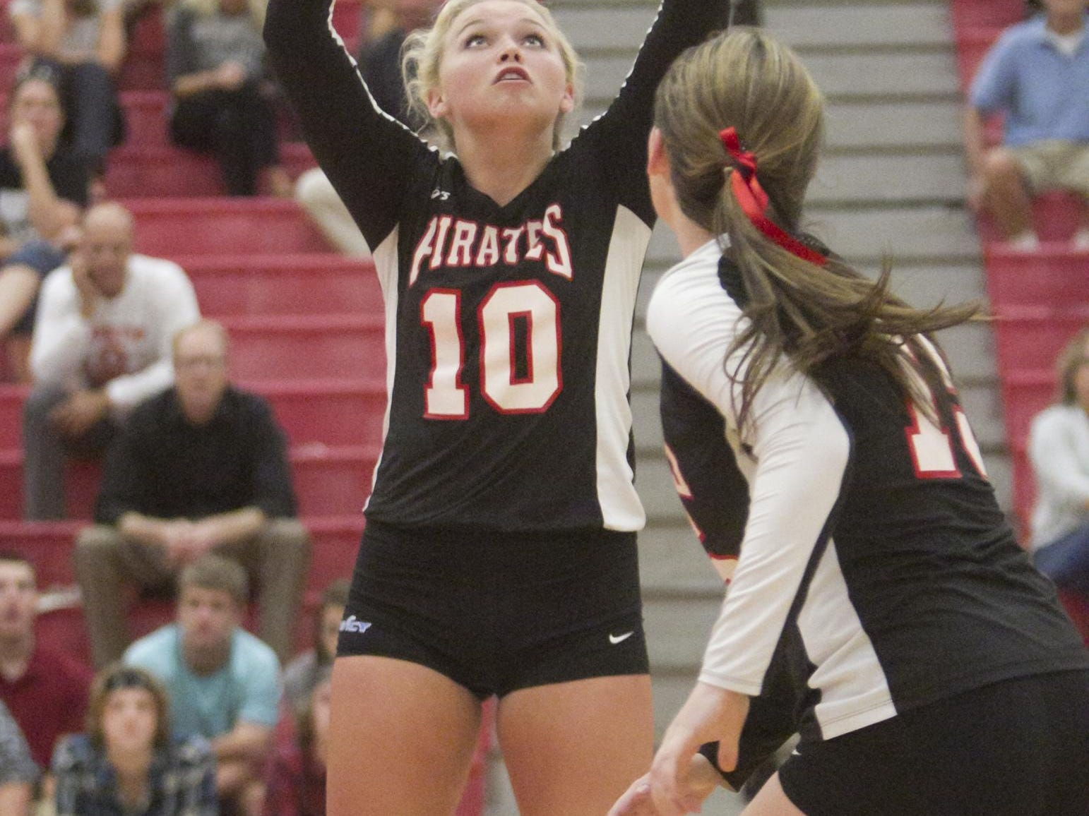 Hannah Kerns of Pinckney sets the ball in Tuesday's game against Brighton. The Bulldogs won in three.