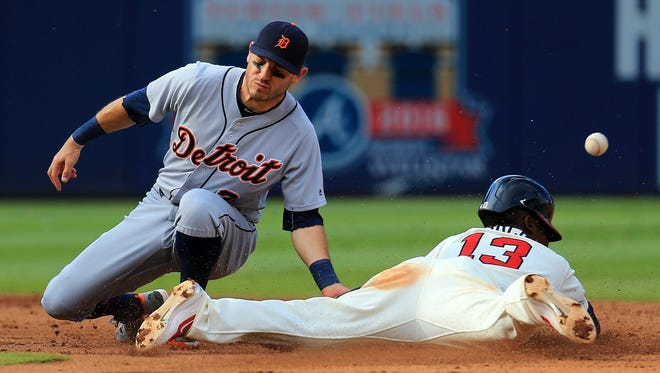 Ian Kinsler of the Detroit Tigers fails to tag out Adonis Garcia of the Atlanta Braves as he steals second in the sixth inning at Turner Field on October 2, 2016 in Atlanta, Georgia.