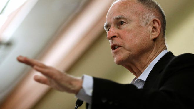 California Gov. Jerry Brown addresses a conference in Sacramento, Calif. Brown directed state oil and gas regulators to investigate the oil and gas potential of his family's ranch land in Northern California, state records obtained by the Associated Press show. Brown saved himself the $200 to $400 hourly cost of hiring a geologist to determine if there was money to be made from his family's mineral deposits, and may have violated state law on diverting public employees and other resources for personal purposes.