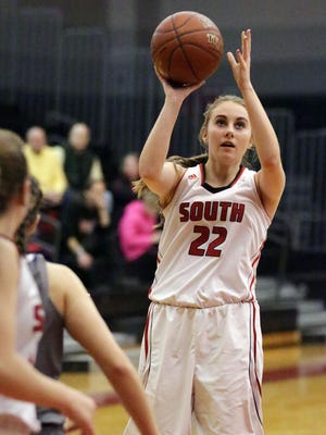 Sheboygan South's Mackenzie Marver (22) aims for an outside basket against Waukesha West Tuesday December 27, 2016 in Sheboygan.