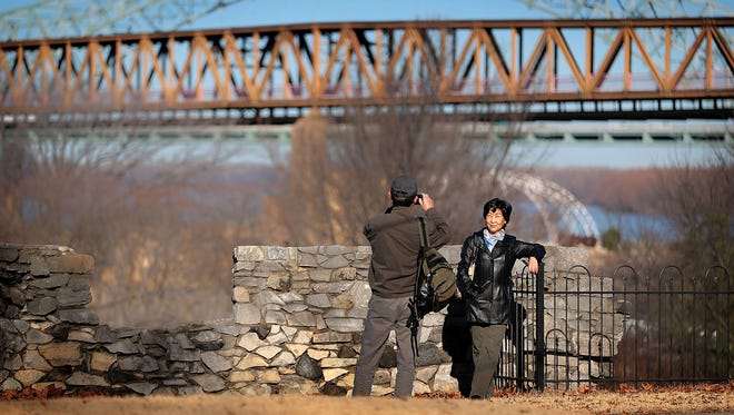You Xu (left) and Lili Xu take a picture from Fourth Bluff Park Thursday morning where Memphis Greenspace Inc., the nonprofit that bought two city parks and removed their Confederate statues in December, announced on Thursday a plan to improve the parks which includes cleaning up walkways, installing seating, adding trashcans, and establishing security measures.