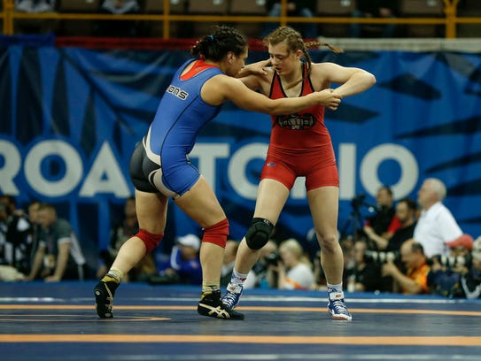 Iowa native Rachel Watters, right, battles Lisa Gonzalez
