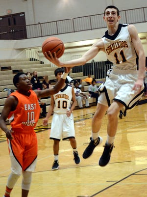 Hendersonville High sophomore guard Cooper Smith hangs in the air before releasing a first-quarter layin in front of East Ridge senior Jeff Thomas. Smith scored nine points in Monday evening's victory.
