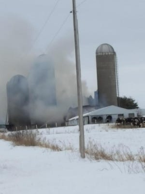 Multiple crews are on the scene of a barn fire Wednesday, April 18, 2018, on Eau Pleine Road, in the Marathon County town of Day.
