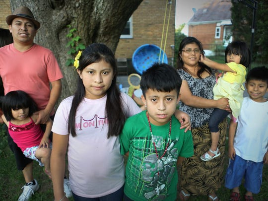 Lindy Reynoso, 12, and her brother Yifry, 10, center, are photographed with their parents, Ever Reynoso and Margarita Vasquez, and their siblings Mercy, 5, Carisma, 3, and Angel, 8. Lindy and Yifry, who crossed the border in April 2014, found out that their immigration cases were closed in the beginning of this year. They are in limbo. Although they were not deported, they did not gain a path to residency or citizenship.Their siblings, all of whom are younger and were born in the U.S., are U.S. citizens.
