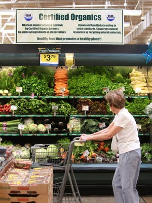 An Indiana resident shopping for organic food. MICHELLE PEMBERTON, THE INDIANAPOLIS STAR
