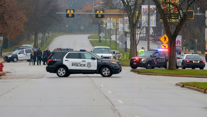 Wauwatosa and Milwaukee police investigate the scene where a 56-year-old pedestrian was killed in a crash on W. Bluemound Road near the Milwaukee County Zoo early Wednesday.
