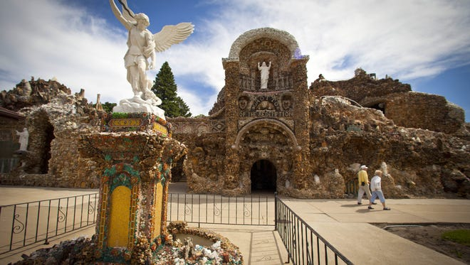 The statue of St Michael, the Archangel, is seen in front of the Grotto of Redemption in West Bend.