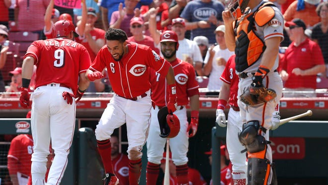 Aug 19, 2018; Cincinnati, OH, USA; Cincinnati Reds second baseman Jose Peraza (9) reacts with center fielder Billy Hamilton (6) after hitting a two-run home run against the San Francisco Giants during the sixth inning at Great American Ball Park. Mandatory Credit: David Kohl-USA TODAY Sports