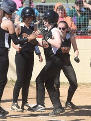 Calico Rock's Megan Hiles is mobbed by teammates at