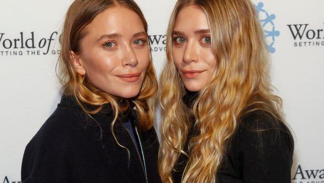 Mary-Kate Olsen, left, and Ashley Olsen attend the 2014 World of Children Awards.