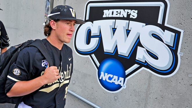 Vanderbilt pitcher Carson Fulmer walks to the dugout before the Texas game at the College World Series at TD Ameritrade Park in Omaha, Neb., Saturday, June 21, 2014.