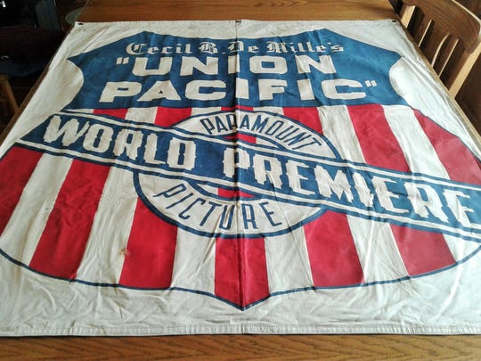 This colorful, well-preserved, two-sided banner measuring