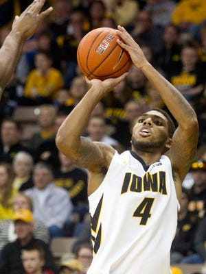 Iowa's Devyn Marble shoots a three during the Hawkeyes game against Purdue on Sunday, March 2, 2014.