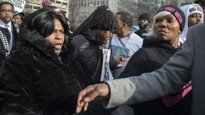 Samaria Rice (left), mother of Tamir Rice, 12, who was shot and killed by a Cleveland police officer, marches Dec. 13, 2014, through the crowd during the Justice For All march in Washington, D.C.