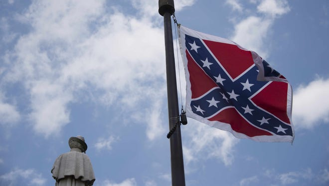 The Confederate flag flies on the grounds of the South Carolina Statehouse.