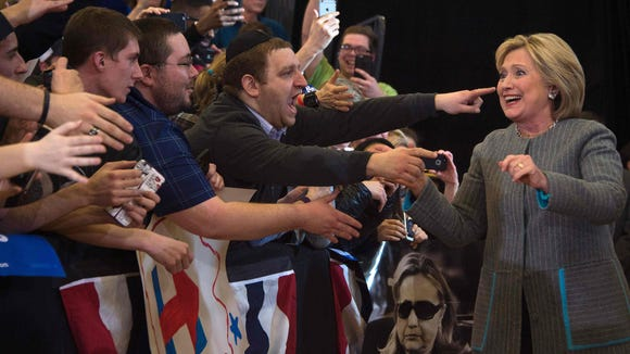 Hillary Clinton greets supporters as she arrives to