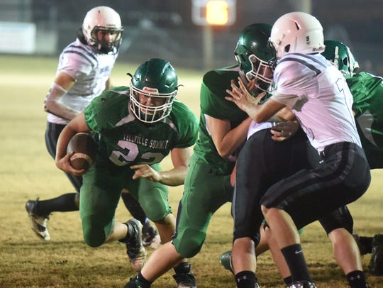 Yellville-Summit's Brock Vigna runs up the middle for
