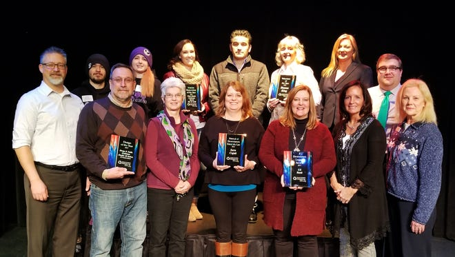 Pictured are 2017 award winners, back row, from left: Brian Krueger, owner, Atlas Gaming; Morgan Crouch, manager, Atlas Gaming; Sarah Palas, manager, Coliseum Sports Bar & Grill; Peter Katris, owner, Coliseum Sports Bar & Grill; Donna King; Amy Hansen, executive director, Downtown Fond du Lac Partnership; Andrew Dengel, Branch manager, US Bank; front row: Alan Hathaway, DFP Board president; Doug and Judie Duitman, owners, Studio 40 Salon; Sara Cujak, owner, Cujak's Wine and Coffee Bar; Kim Schmitz, vice president-district manager, US Bank; Anne Pierce, assistant vice president, US Bank; and Melanie Fox, executive assistant, US Bank.