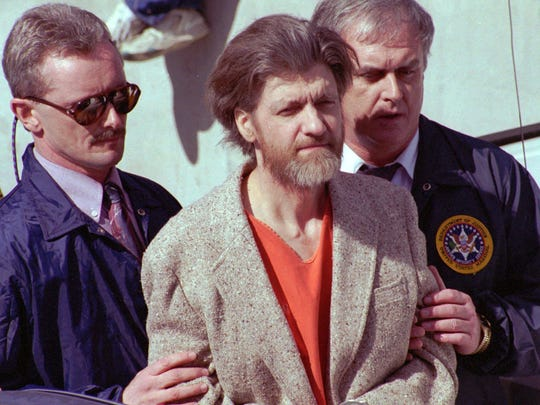 FILE - In this April 4, 1996 file photo, Unabomber Theodore John Kaczynski is flanked by federal agents as he is led to a car from the federal courthouse in Helena, Mont.