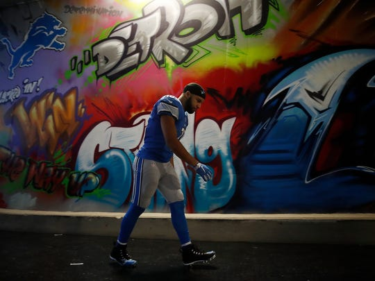 Lions receiver Golden Tate walks up the tunnel after