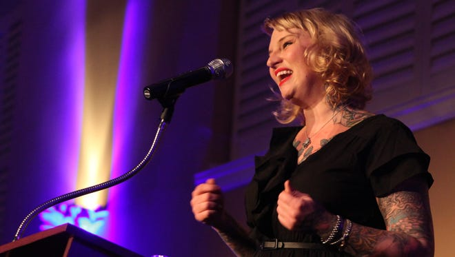 Local mixologist and bar owner Molly Wellmann tells a crowd of more than 400 the story of why she loves Cincinnati at the inaugural StoryTellers night at the Phoenix on Wednesday.