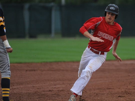 Richmond's Thomas Stanley rounds third base and heads