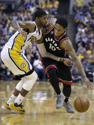 Raptors guard DeMar DeRozan tries to get around Pacers forward Paul George in the second half of their Eastern Conference first-round playoff game Saturday.