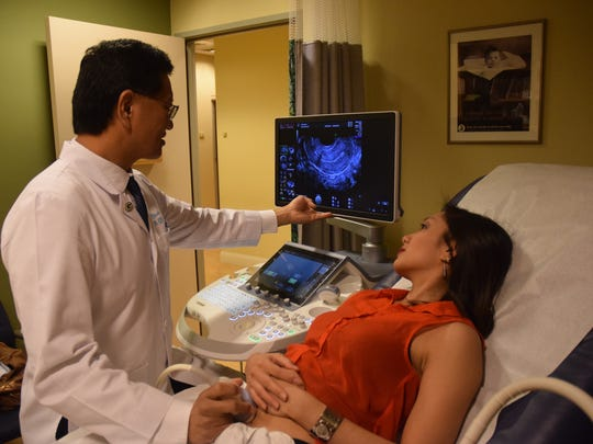 Dr. Thomas Shieh, MD obstetrics and gynecologist, performs