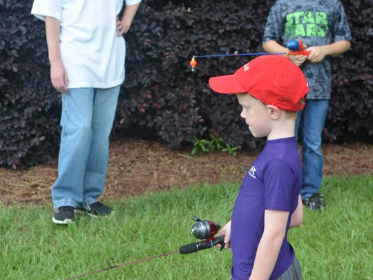 Nathaniel Skinner awaits to throw his rod in a casting contest held by R.E. Thompson at Pecan Lakes Subdivision in Sunrise.